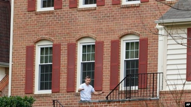 Ruslan Tsarni, the uncle of the Boston Marathon bombing suspects, walks into his home in Maryland.