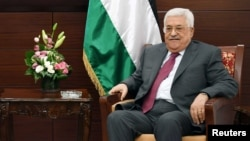 FILE - Palestinian President Mahmoud Abbas is seen in his office in the West Bank city of Ramallah, June 21, 2017.
