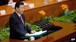 China's newly-installed President Xi Jinping speaks at the closing ceremony of the National People's Congress at the Great Hall of the People in Beijing Sunday, March 17, 2013.
