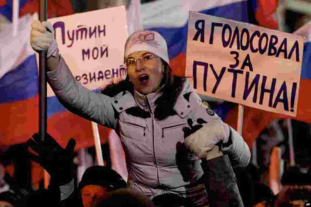 "Supporters of Russian Prime Minister Vladimir Putin rally at Manezh square outside Kremlin, in Moscow, Russia, March 4, 2012. Posters read ""Putin is my president,"" ""I voted for Putin."" (AP)"