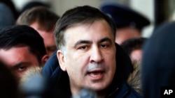 Former Georgian president Mikheil Saakashvili speaks with journalists near the Fairmont Grand Hotel in Kiev, Ukraine, Friday, Feb. 9, 2018. Saakashvili claimed that unidentified armed people wearing military uniform tried to arrest him inside the hotel on Friday.