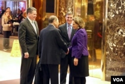 "Retired Lt. General Michael Flynn — Trump's pick for national security adviser — is seen with Maurice ""Hank"" Greenberg and K.T. McFarland at Trump Tower in New York, Dec. 12, 2016. (R. Taylor/VOA)"