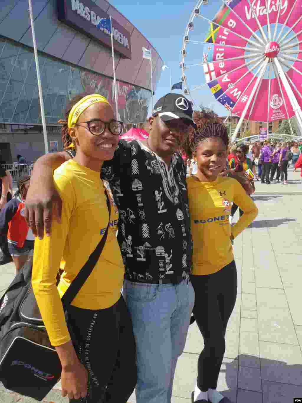 Gems Players Patricia Mauladi & Elsur Ndlovu with Zimbabwe supporter Thamsanqa Mpofu from Leeds