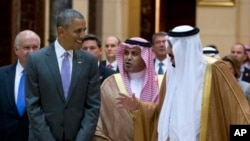 President Barack Obama and Saudi Arabia's King Salman walk to President Obama's motorcade after meeting at Erga Palace in Riyadh, Saudi Arabia, Wednesday, April 20, 2016. The president began a six day trip to talk with his counterparts in Saudi Arabia, England and Germany. (AP Photo/Carolyn Kaster)