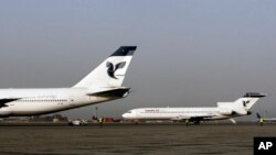 In this March 2, 2008 file photo, two passenger planes of Iran's national air carrier, Iran Air, are parked at the Mehrabad Airport in Tehran, Iran.