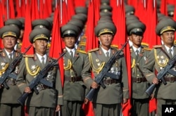 FILE - North Korean soldiers parade in Pyongyang, North Korea, Oct. 10, 2015.