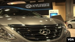 FILE - A new Hyundai under the lights at an auto show.