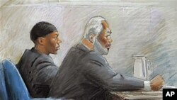 In this courtroom drawing, Umar Farouk Abdulmutallab (L) appears in federal court with Anthony Chambers, a lawyer who is assisting him in his defense, in Detroit, October 4, 2011.