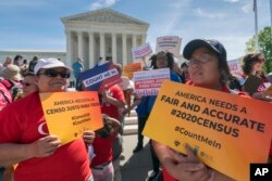FILE - Immigration activists rally outside the Supreme Court as the justices hear arguments over the Trump administration's plan to ask about citizenship on the 2020 census, in Washington, April 23, 2019.