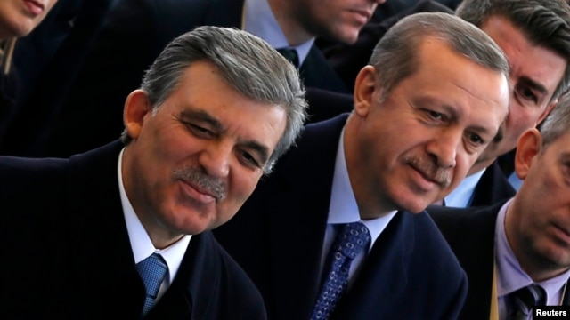 Turkish President Abdullah Gul (L) and Prime Minister Tayyip Erdogan (C) arrive at the opening ceremony of a new line of the Ankara Metro, in Ankara, Feb. 12, 2014.