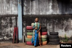 Singer Temi Dollface poses for a picture in the compound where she works from, in the Ikeja district of Lagos, Nigeria, May 18, 2016.