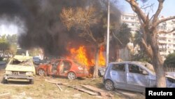Vehicles burn after an explosion in central Damascus. (February 21, 2013)