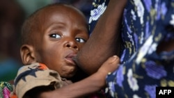 A Malawian child, suffering from HIV, breastfeeds at the Zomba NRU (Nutritional and Rehabilitation Unit), 60 kms south of Blantyre, October 14, 2005 file photo.