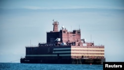 "The Russian ""Academy Lomonosov,"" the world's first floating nuclear power plant, passes Langeland island, while heading for Murmansk in northwestern Russia, May 4, 2018."