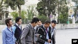 12일 아침 학교로 향하는 다마스쿠스 시 학생들.