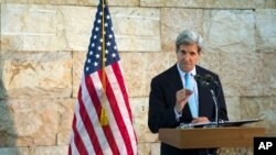 U.S. Secretary of State John Kerry speaks about his trip to the Middle East during a news conference in Tel Aviv, Israel, June 30, 2013.