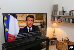 French President Emmanuel Macron speaks during a television address, Monday, March 16, 2020 in Ciboure, southwestern France. For most people, the new coronavirus causes only mild or moderate symptoms.