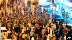 Anti-riot police stand-off with protesters in the Gulf coast town of Awwamiya, Saudi Arabia, March 3, 2011
