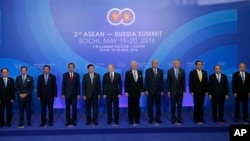Russian President Vladimir Putin (center) and leaders from the Association of Southeast Asian Nations (ASEAN) pose for a group photo at the ASEAN - Russia summit in Sochi, Russia, Friday, May 20, 2016.
