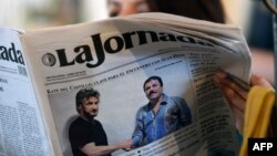"A woman reads La Jornada newspaper in Mexico City, on January 10, 2016 which shows a picture of drug lord Joaquin Guzman, aka ""El Chapo"" (R), shaking hands with US actor Sean Penn."