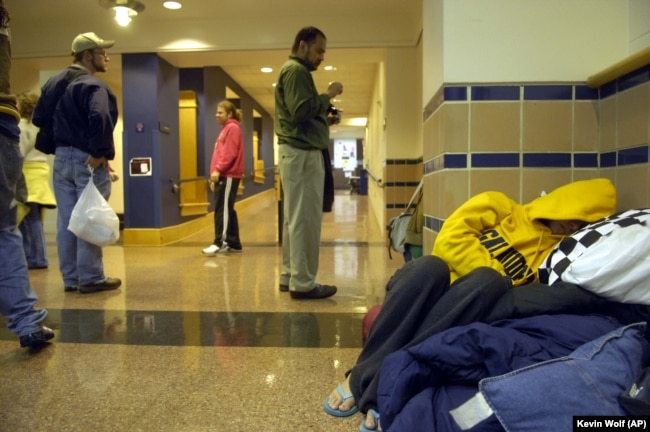 A student sleeps in the hallway of Hall Memorial Building on the campus of Gallaudet University on Friday, October 6, 2006, in Washington, DC.