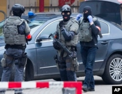 FILE - Special operations police secure an area during a police raid in the Molenbeek neighbourhood of Brussels, Belgium on March 18, 2016.