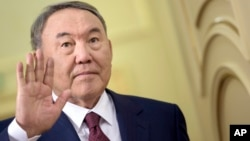 FILE - Kazakh President Nursultan Nazarbayev gestures at the Presidential Palace in Astana, Kazakhstan, Nov. 2, 2015.
