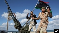 FILE - Libyan militia members from towns throughout the country's west parade through Tripoli, Feb. 2012.
