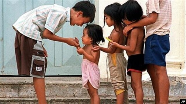 Cambodian orphans play together as they wait for adoption at Kien Klaing orphanage center in Phnom Penh, (file photo).