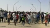Sudanese demonstrators march and chant during a protest against the military takeover, in Atbara, Sudan, October 27, 2021, in this social media image.