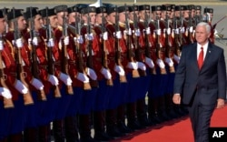 FILE - U.S. Vice President Mike Pence attended a welcome ceremony at Golubovci airport, near Podgorica, Montenegro, Aug. 1, 2017. Pence attended the Adriatic Charter Summit in NATO's newest member — Montenegro.