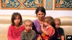 Abeer Shalgheen dan keempat anaknya yang diculik dari Sweida, 25 Juli 2018, telah dibebaskan kelompok ISIS. (Foto: SANA/dok).