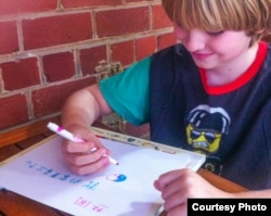 American elementary school student practicing Chinese