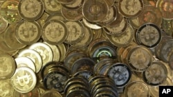 A pile of bitcoin tokens - a retro-futuristic kind of prepaid currency that made its debut four years ago - are shown in April 2013.