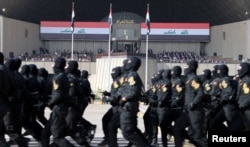 Iraqi Prime Minister Haider al-Abadi attends the celebrates victory over Islamic State militants with military parade in Baghdad, July 15, 2017.