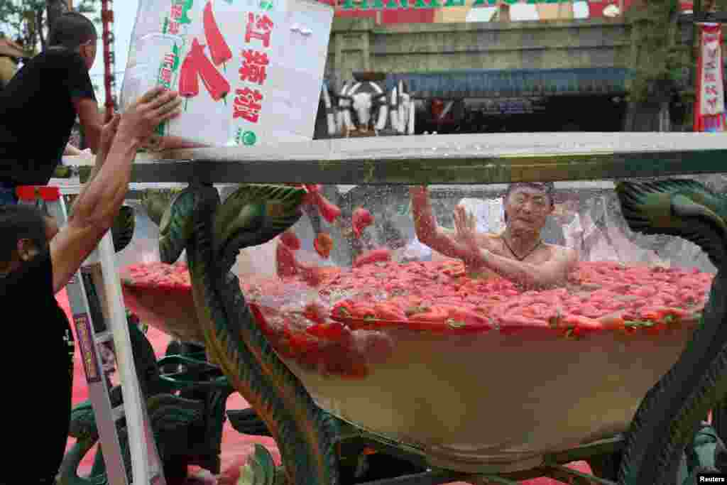 A man takes part in a chili-eating competition in Ningxiang, Hunan province, China, Aug. 12, 2017.