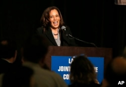 FILE - U.S. Sen. Kamala Harris, a candidate for the 2020 Democratic presidential nomination, addresses labor leaders at the California Labor Federal and State Building and Construction Trades Council Legislative Conference Dinner, April 1, 2019, in Sacramento.