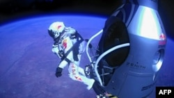 Felix Baumgartner of Austria jumping out of the capsule