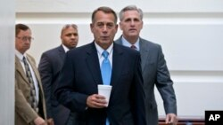 Speaker of the House John Boehner, R-Ohio, with House Majority Whip Kevin McCarthy, R-Calif., right, walks to a meeting of House Republicans at the Capitol on Oct. 15, 2013, as a partial government shutdown enters its third week.