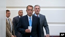 FILE - Speaker of the House John Boehner, R-Ohio, with House Majority Whip Kevin McCarthy, R-Calif., right, walks to a meeting of House Republicans at the Capitol in Washington.