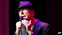 FILE - Leonard Cohen performs at The Fabulous Fox Theatre in Atlanta, March 22, 2013. Cohen, the gravelly-voiced Canadian singer-songwriter died Nov. 10, 2016, at age 82.