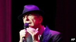 FILE - Leonard Cohen performs at The Fabulous Fox Theatre in Atlanta, March 22, 2013. Cohen, the gravelly-voiced Canadian singer-songwriter died Thursday, November 10, 2016, at age 82.
