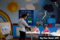 Children attend classes at a foster home of the New Hope Foundation on the outskirts of Beijing, China on Wednesday, Oct. 11, 2017.