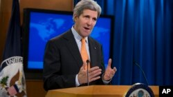 FILE - U.S. Secretary of State John Kerry talks about Syria at the State Department in Washington, Jan. 16, 2014.