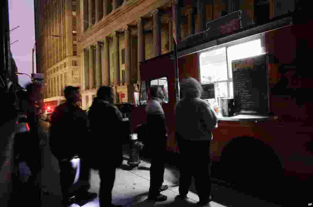 People line up at a coffee truck in New York's financial district, Oct. 31, 2012 ahead of the first opening for Wall Street this week following a two-day shutdown due to superstorm Sandy.