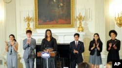 First Lady Michelle Obama hosts a poetry reading in honor of the 2016 National Student Poets, from left: Maya Salameh, Joey Reisberg, Gopal Raman, Maya Eashwaran and Stella Binion in the State Dining Room of the White House on Thursday, Sept. 8, 2016 in W