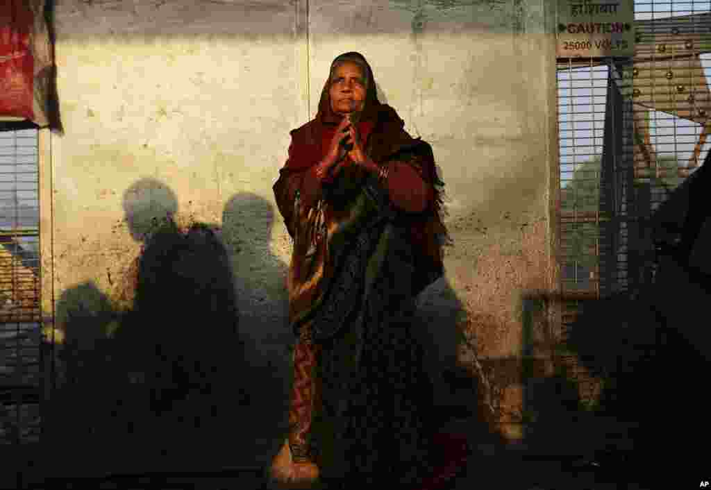 A woman stands on a platform near where a stampede took place a night before, at the station in Allahabad, India, Feb. 11, 2013.
