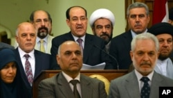 aq's prime minister for the past eight years, Nouri al-Maliki, speaks at a podium surrounded by Iraqi lawmakers, during an address to the nation, announcing that he is stepping down in Baghdad, Iraq, Aug. 14, 2014.