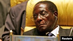 FILE - Zimbabwe's President Robert Gabriel Mugabe closes his eyes during the Africa Union meeting in Sirte, Libya, July 4, 2005.