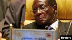 FILE - Zimbabwe's President Robert Gabriel Mugabe closes his eyes during the Africa Union meeting in Sirte, Libya, July 4, 2005.